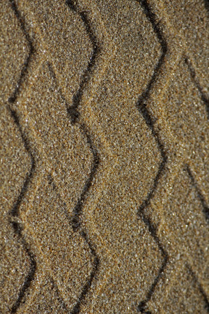 Tire Print In Sand Stock Photo - 28421595
