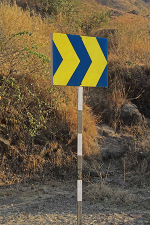 Road sign board showing turning driving directions Katraj Highway photo