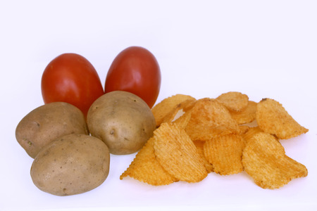 Ridged Potato Chips with Potatoes and Tomatoes photo