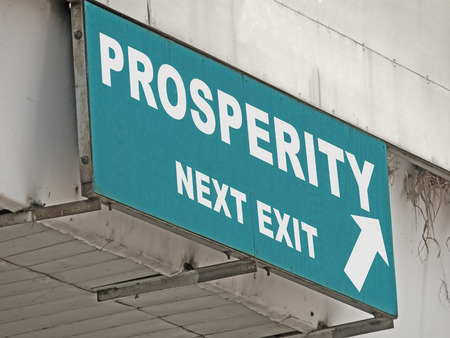 A Notice Board On A National Highway Showing Prosperity Next Exit, Concept photo