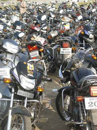 Motorcycles, bikes are parked at parking place