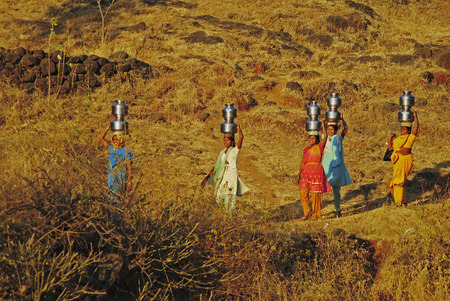 Young women Carrying water from the local well, Maharashtra, India