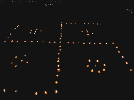 Panati, small oil lamps during Diwali, festival of lights in India, Diyas are arranged in form of holi sign, Swastik photo
