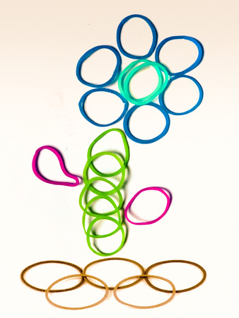 Rubber bands with different colors are arranged in floral pattern photo