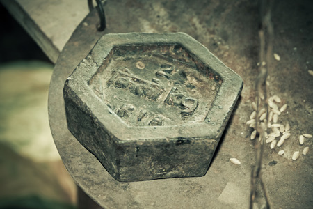 an old two kg hexagon shaped weight at indian market photo