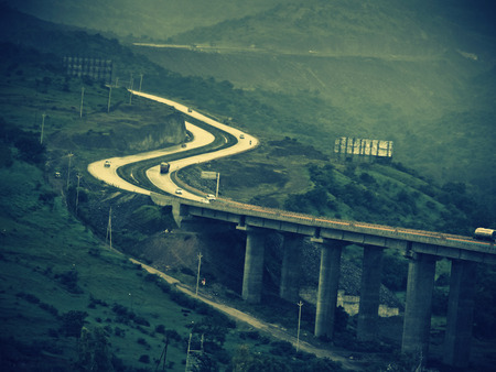 pune: A very tall valley bridge, national Pune_Banglore highway in curved form, Pune, Maharashtra, India