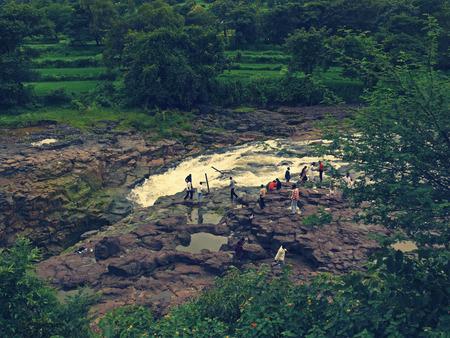 maharashtra: People at Water string in monsoon, Baneshwar, Maharashtra, India