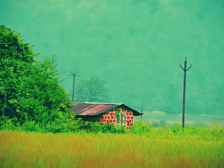 journeying: Traditional house with sloping roof, Kokan, Maharashtra, India Stock Photo