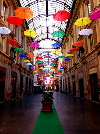 Genoa, Italy - 04/06/2019: Rainbow gay pride protection symbol in hanging umbrellas over the city Editorial