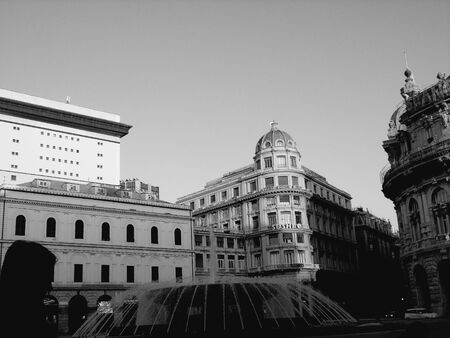 Genoa, Italy - 01/22/2020: Panoramic view to the city center of Genoa in winter beautiful day. Amazing view to the old architecture with blue sky in the background and the moon over the city. 스톡 콘텐츠 - 138473547