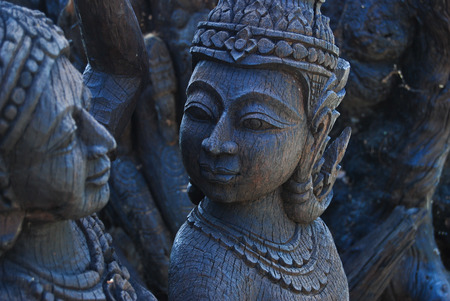 thai people: the wood angle what carve by thai people Stock Photo