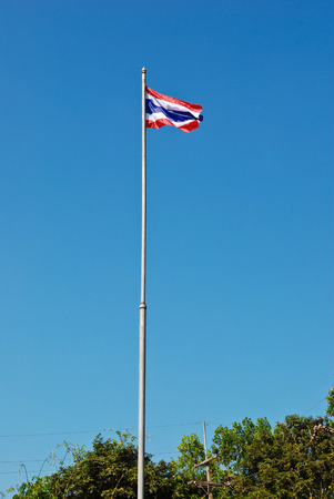 the thai flag stand in front of school thailand
