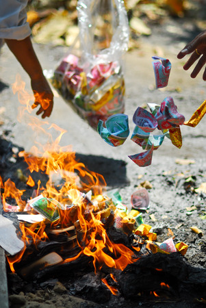 chinese people fire the forge money paper for die ancestor festival