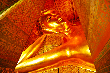 buddhist temple: the image of gold color buddha in the temple bangkok thailand Stock Photo