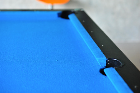 the Background of blue woolen fabric flannel felt snooker table and hole Banque d'images