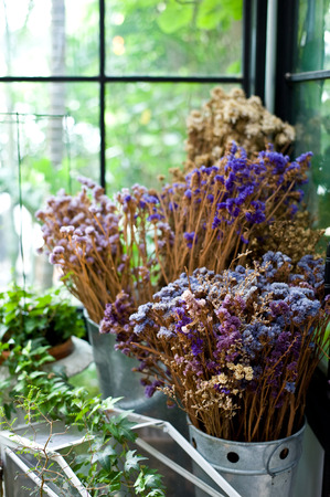 dried flower arrangement: the Dry leaf and branch flower in vase or pot in garden at home is the interior design vintage style