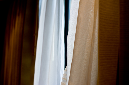the curtain install at window of bedroom for protect light from the sun between sleep Stock Photo
