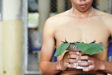 Kanchanaburi, Thailand - Feb 18 : Thai man who age over 20 years old prepare to ordain in Buddhism for learning the dharma on the Feb 18, 2011 in Kanchanaburi, Thailand.