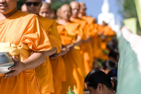 Khon Kaen, Thailand - Oct 28 : Tak Bat Devo Rohana is the Festival of buddhism for give food offerings to a Buddhist monk in the End of Buddhist Lent Day on the Oct 28, 2015 in Ubolratana District, Khon Kaen, Thailand.