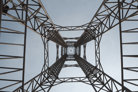 the steel structure of tower on blue sky background so tall and high building