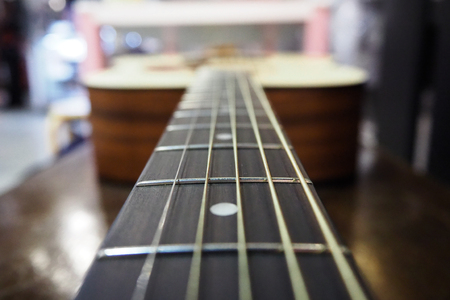 String of acoustic guitar in studio music instrument Imagens