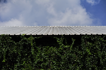 roof on blue sky cloud background