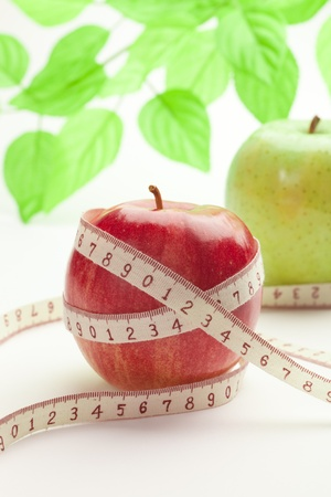 apple with a tape measure for diet Stock Photo