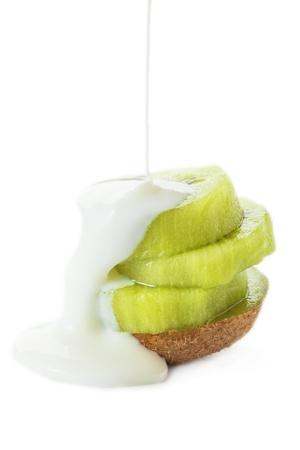 sliced kiwifruit with yoghurt on the white background