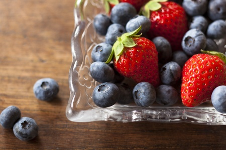strawberries and blueberries on the wood table Stock Photo