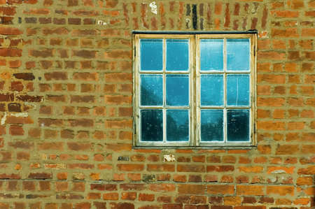 defaced: old brick wall and window