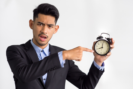 Businessmanbossmanager showing alarm clock on white background, working time, late, punctual concept.
