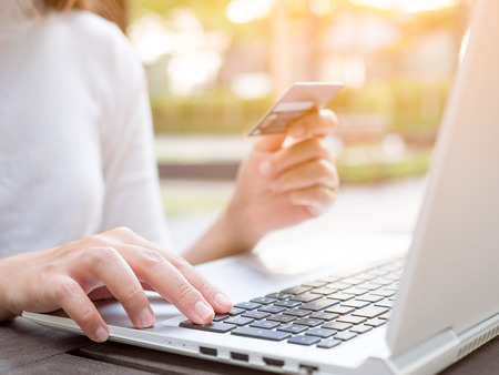 Business woman using credit card and laptop for online shopping, online payment, network internet banking