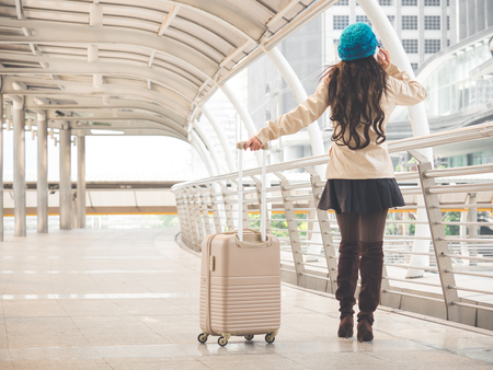 Woman traveler with bag, luggage, suitcase arrival at the airport during travel