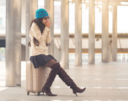 Woman traveler with bag, luggage, suitcase arrival at the airport during traveling, Stock Photo