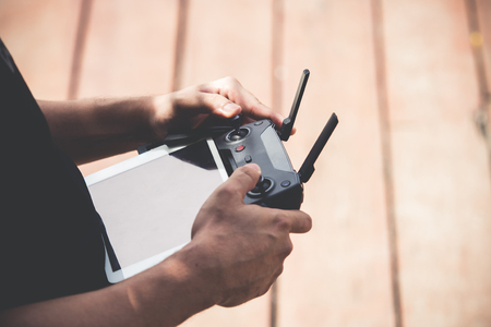Man holding remote controller for drones flying Stock Photo