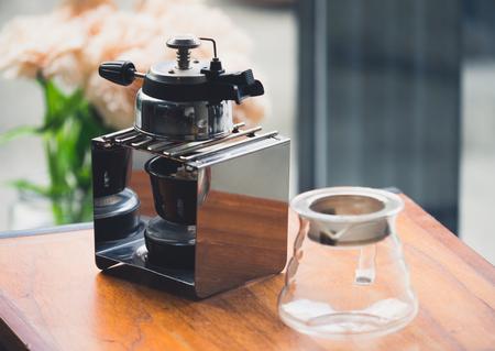 Old tea maker on wood table, vintage tone Stock Photo