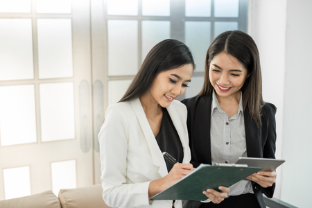Young asian businesswoman in modern office, discussing business with colleague during meeting and interview Stock Photo