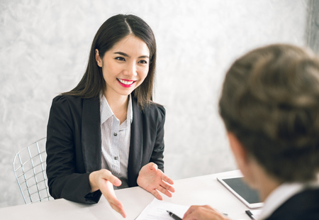 Asian business woman discussing/job interview with colleauge/boss for business meeting 版權商用圖片
