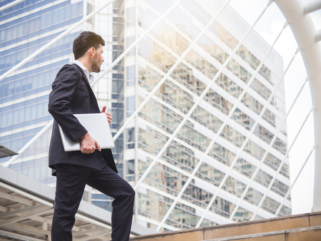 Businessman walking stepping up stair in modern city, business growth, go up, success, grow up business concept