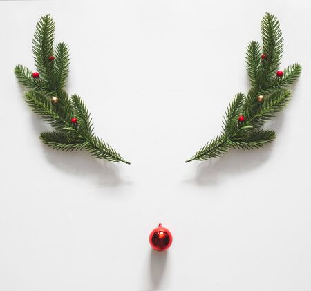 Reindeer made of christmas decoration over white background for christmas concept. flatlay