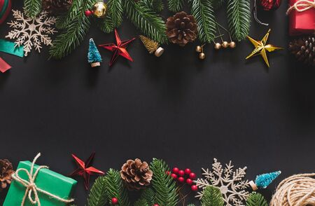 Christmas background with christmas decoration over black background with copy space. top view flatlay 스톡 콘텐츠
