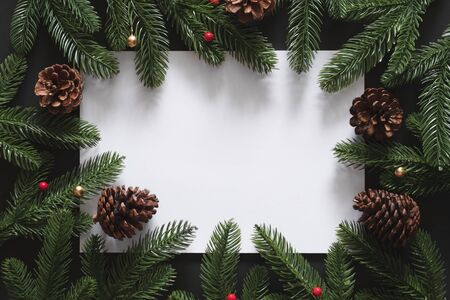 Christmas background with blank empty copy space white box for text with christmas tree and pinecone decoration. flatlay topview 스톡 콘텐츠