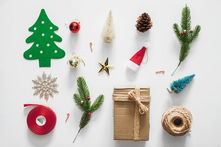 Christmas background with decorations over white background. flatlay