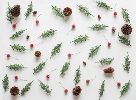 Christmas background, frame with fir branches tree pinecone over white background. flatlay copy space