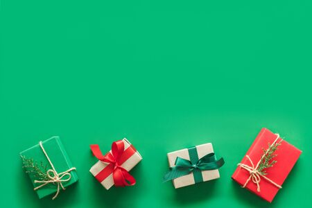 Christmas background with gift present over green background with copy space. flatlay topview