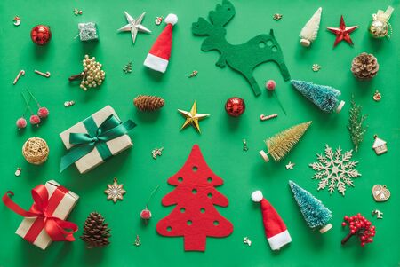 Christmas background with decorations over green background. flatlay