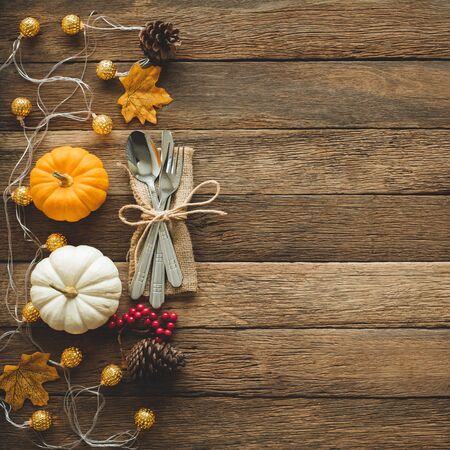 Thanksgiving background, pumpkin, leaves and decoration on wood table background with copy space. flatlay Reklamní fotografie