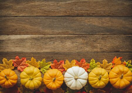 Thanksgiving background, pumpkin, leaves and decoration on wood table background with copy space. flatlay Фото со стока