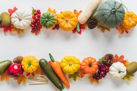 Thanksgiving background, pumpkin fruits vegetable, leaves and decoration on white background with copy space. flatlay