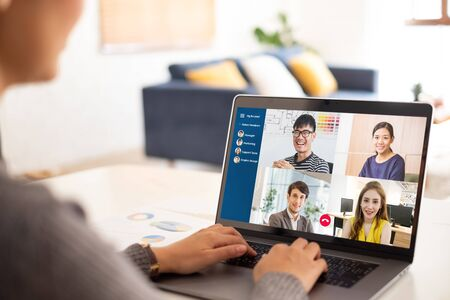 Young Asian businesswoman work at home and virtual video conference meeting with colleagues business people, online working, video call due to social distancing